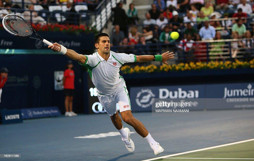 Serbia's Novak Djokovic returns the ball to Argentina's Juan Martin Del Potro during their ATP Dubai Open tennis semi-final match in the Gulf emirate on March 1, 2013. Djokovic won the match 6-3, 7-6.