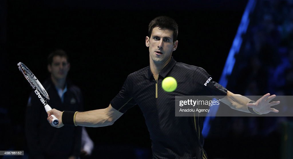 Serbia's Novak Djokovic returns the ball to Croatia's Marin Cilic during their Group A singles match on day two of the ATP World Tour Finals tennis tournament at 02 Arena in London, England on November 10, 2014.