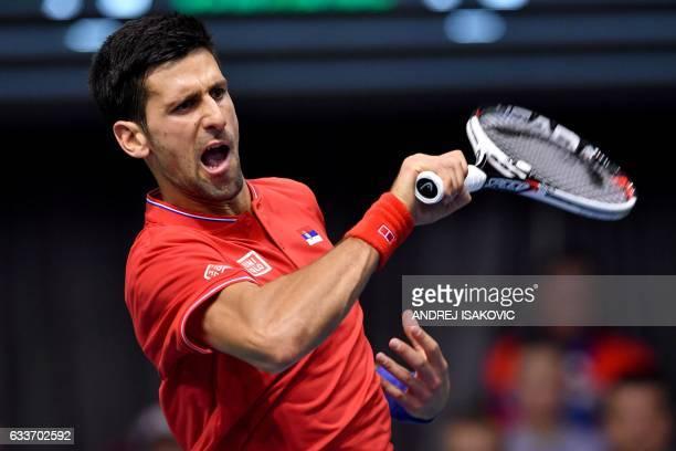 TOPSHOT Serbia's Novak Djokovic returns the ball to Russia's Daniil Medvedev during the Davis Cup World Group first round singles tennis match...