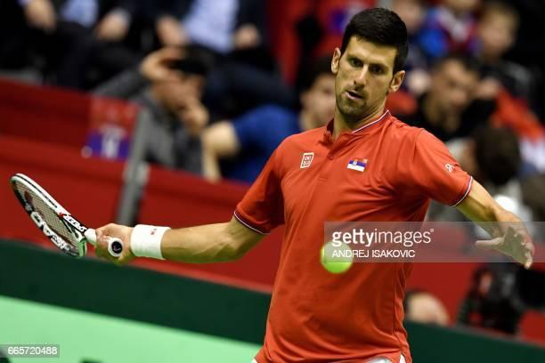 Serbia's Novak Djokovic returns the ball to Spain's Albert RamosVinolas during the Davis Cup World Group quarterfinals single match between Serbia...