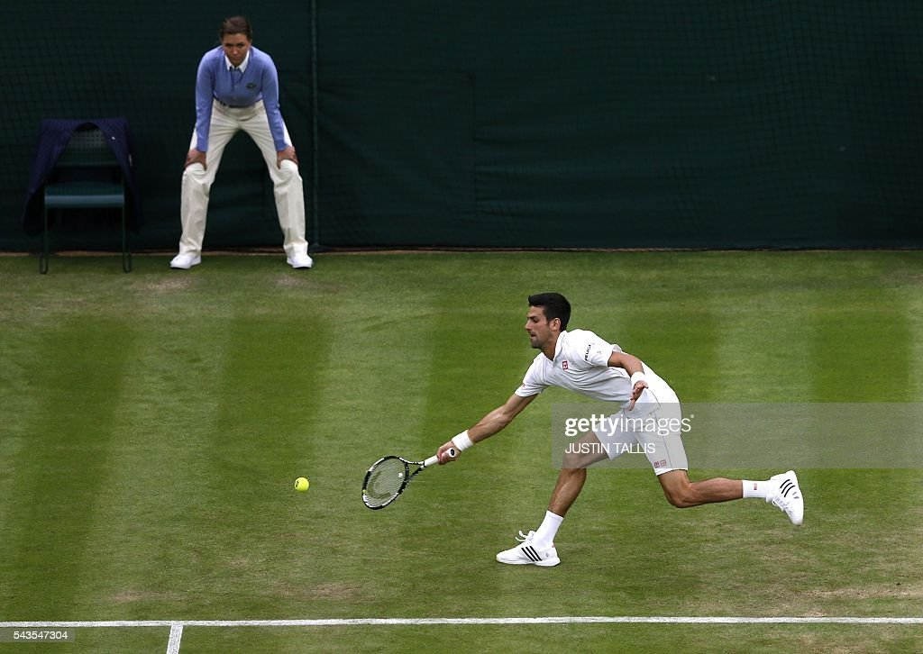 Serbia's Novak Djokovic returns to France's Adrian Mannarino during their men's singles second round match on the third day of the 2016 Wimbledon Championships at The All England Lawn Tennis Club in Wimbledon, southwest London, on June 29, 2016. / AFP / JUSTIN
