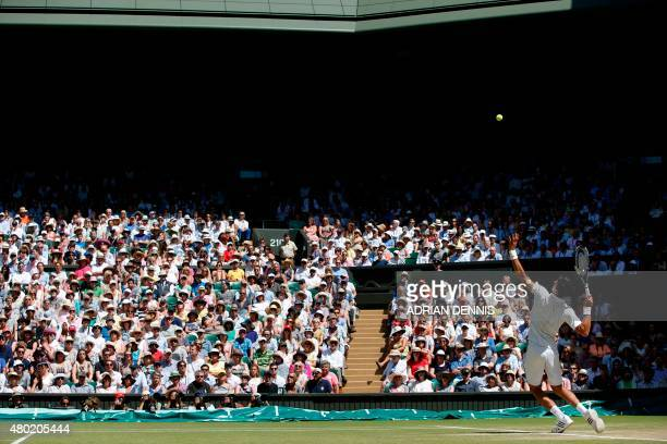 Serbia's Novak Djokovic returns to France's Richard Gasquet during their men's semifinal match on day eleven of the 2015 Wimbledon Championships at...