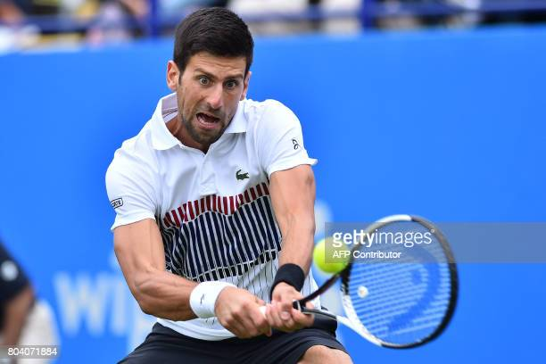 Serbia's Novak Djokovic returns to Russia's Daniil Medvedev during their men's semifinal tennis match at the ATP Aegon International tennis...