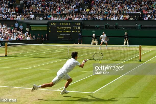 Serbia's Novak Djokovic returns to Switzerland's Roger Federer during their men's singles final match on Centre Court on day thirteen of the 2015...