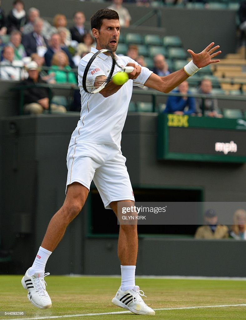 Serbia's Novak Djokovic returns to US player Sam Querrey during their men's singles third round match on the fifth day of the 2016 Wimbledon Championships at The All England Lawn Tennis Club in Wimbledon, southwest London, on July 1, 2016. / AFP / GLYN