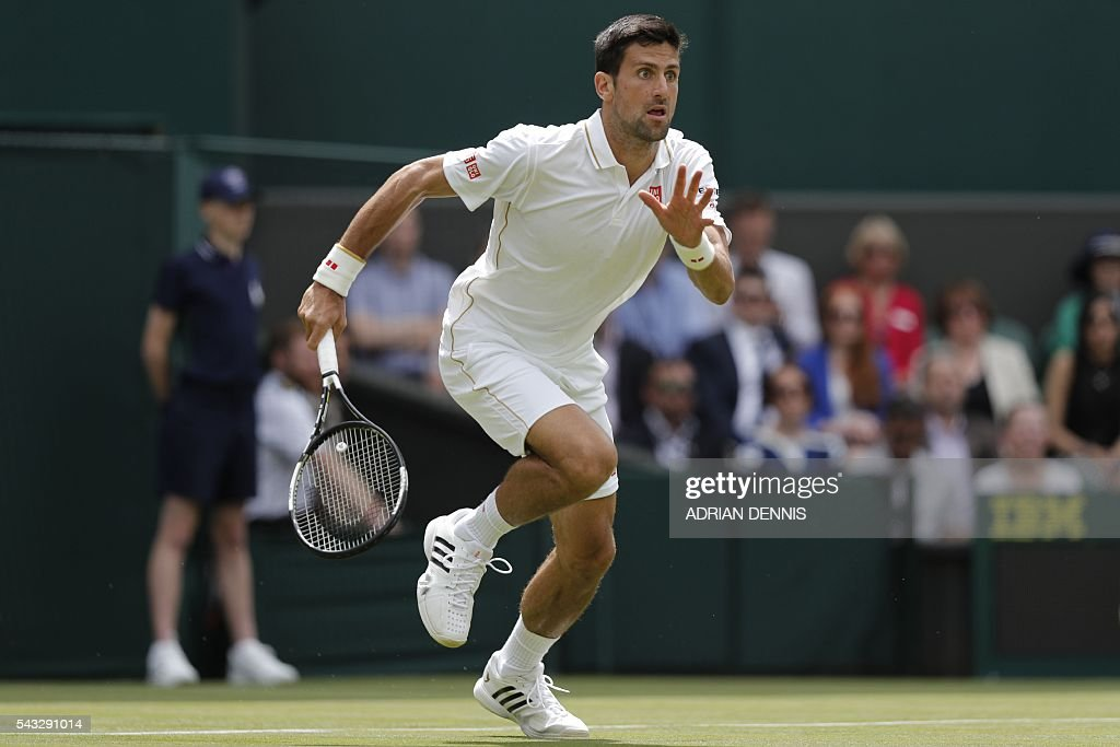 Serbia's Novak Djokovic runs to reach a return against Britain's James Ward during their men's singles first round match on the first day of the 2016 Wimbledon Championships at The All England Lawn Tennis Club in Wimbledon, southwest London, on June 27, 2016. / AFP / ADRIAN