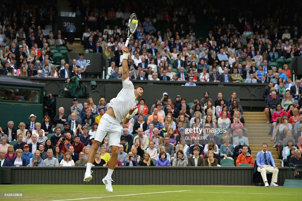 Serbia's Novak Djokovic serves against France's Adrian Mannarino during their men's singles second round match on the third day of the 2016 Wimbledon Championships at The All England Lawn Tennis Club in Wimbledon, southwest London, on June 29, 2016. / AFP / GLYN