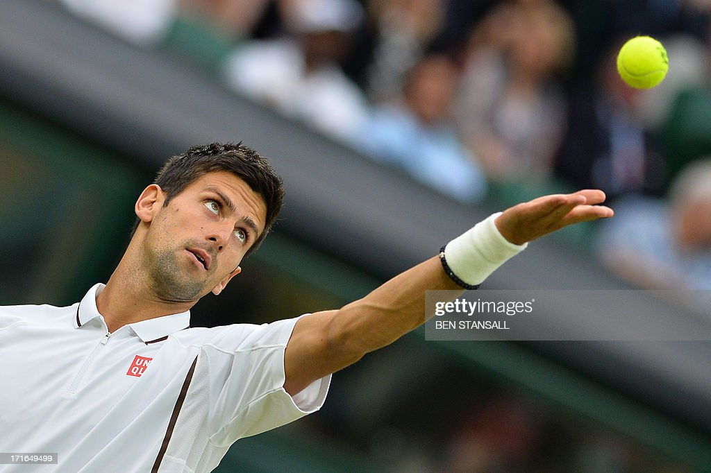 Serbia's Novak Djokovic serves against US player Bobby Reynolds during their second round men's singles match on day four of the 2013 Wimbledon Championships tennis tournament at the All England Club in Wimbledon, southwest London, on June 27, 2013.