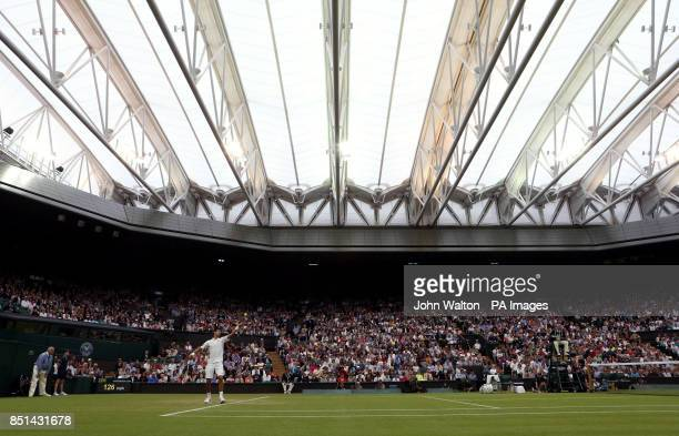 Serbia's Novak Djokovic serves against USA's Bobby Reynolds under the roof on centre court during day four of the Wimbledon Championships at The All...