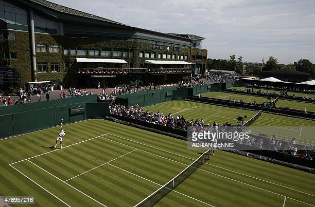 Serbia's Novak Djokovic serves during a practice session on day one of the 2015 Wimbledon Championships at The All England Tennis Club in Wimbledon...