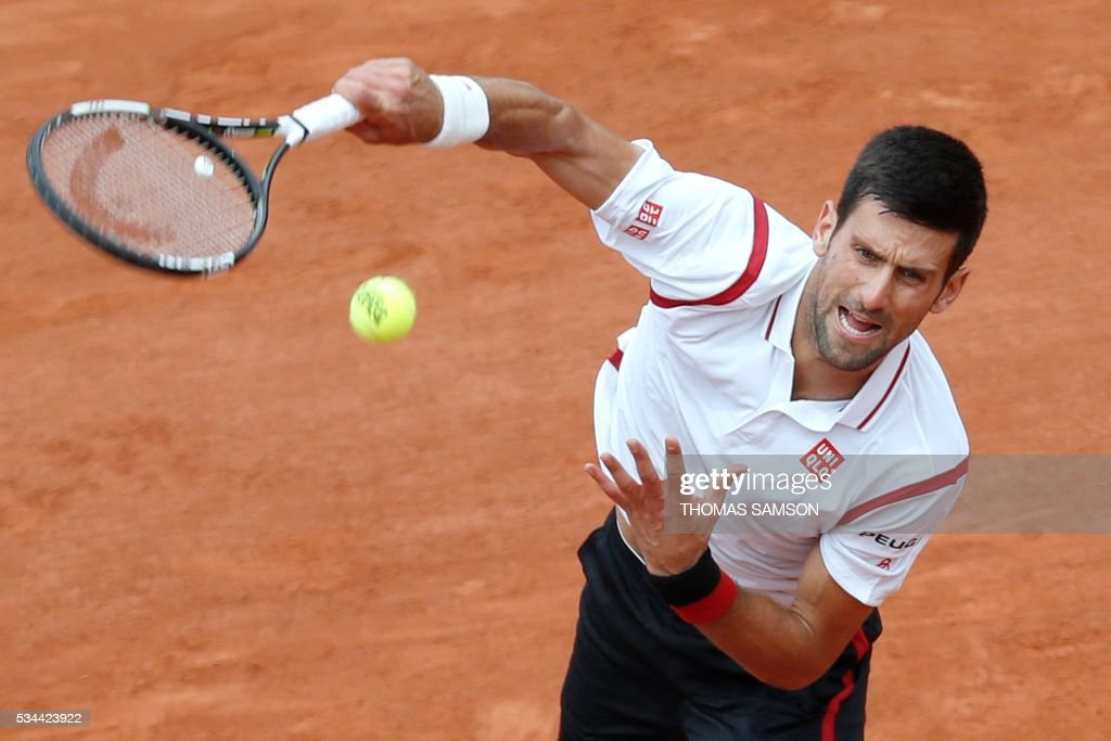 Serbia's Novak Djokovic serves the ball to Belgium's Steve Darcis during their men's second round match at the Roland Garros 2016 French Tennis Open in Paris on May 26, 2016. / AFP / Thomas SAMSON