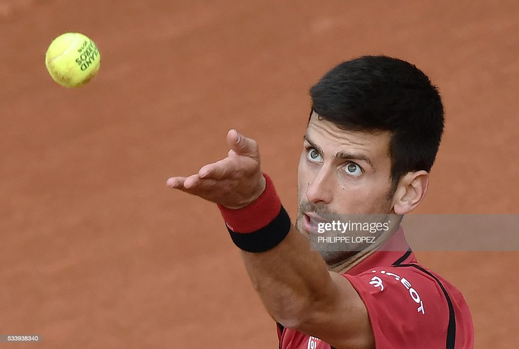 Serbia's Novak Djokovic serves the ball to Taiwan's Lu Yen-Hsun during their men's first round match at the Roland Garros 2016 French Tennis Open in Paris on May 24, 2016. / AFP / PHILIPPE