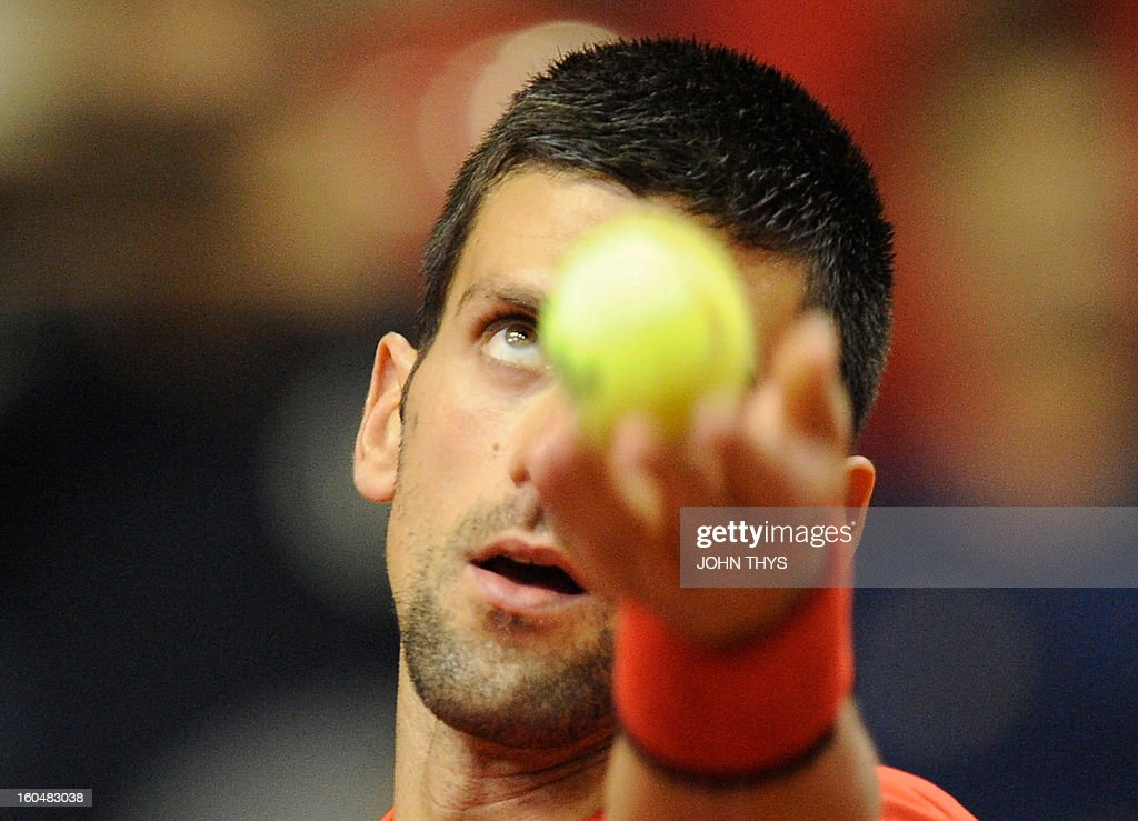 Serbia's Novak Djokovic serves to Belgium's Olivier Rochus during their Davis Cup World Group first round tennis match on February 1, 2013 in Charleroi.