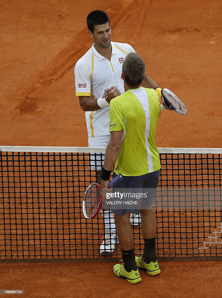 Serbia's Novak Djokovic (top) shakes hands with Finland's Jarkko Nieminen at the end of their Monte-Carlo ATP Masters Series Tournament tennis match on April 19, 2013 in Monaco. Djokovic won 6-4, 6-3.