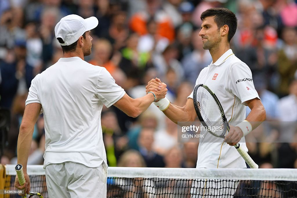 Serbia's Novak Djokovic (R) shakes hands with France's Adrian Mannarino (L) after Djokovic won their men's singles second round match on the third day of the 2016 Wimbledon Championships at The All England Lawn Tennis Club in Wimbledon, southwest London, on June 29, 2016. / AFP / GLYN