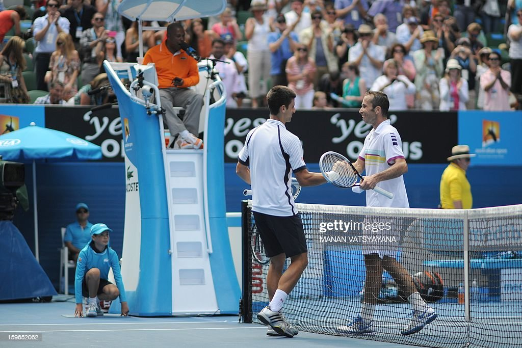 Serbia's Novak Djokovic (L) shakes hands with the Czech Republic's Radek Stepanek (R) after his victory during their men's singles match on day five of the Australian Open tennis tournament in Melbourne on January 18, 2013.