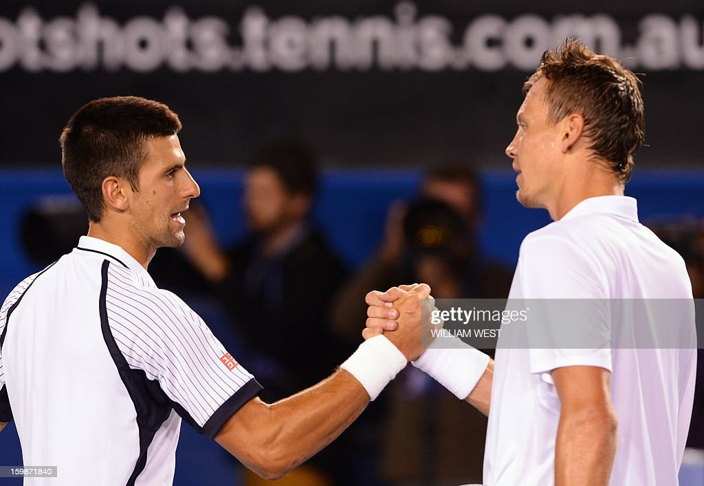 Serbia's Novak Djokovic (L) shakes hands with the Czech Republic's Tomas Berdych after his victory during their men's singles match on day nine of the Australian Open tennis tournament in Melbourne on January 22, 2013.