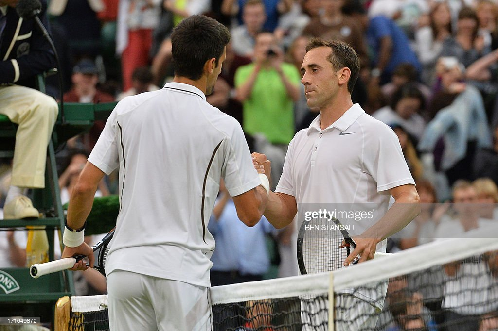 Serbia's Novak Djokovic (L) shakes hands with US player Bobby Reynolds (R) after beating him in their second round men's singles match on day four of the 2013 Wimbledon Championships tennis tournament at the All England Club in Wimbledon, southwest London, on June 27, 2013. Djokovic won 7-6, 6-3, 6-1.