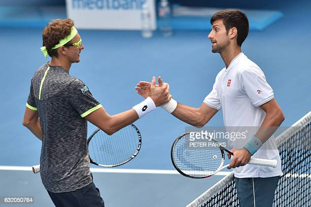 Serbia's Novak Djokovic shakes hands with Uzbekistan's Denis Istomin after defeat during their men's singles second round match on day four of the...
