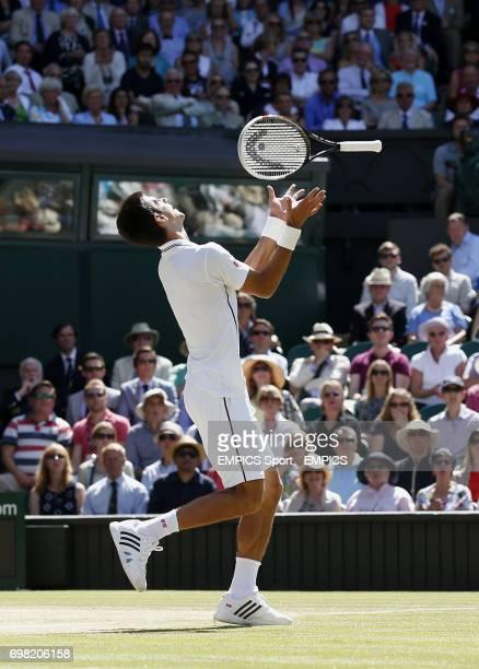 Serbia's Novak Djokovic throws his racquet in the air in his Semi Final against Bulgaria's Grigor Dimitrov