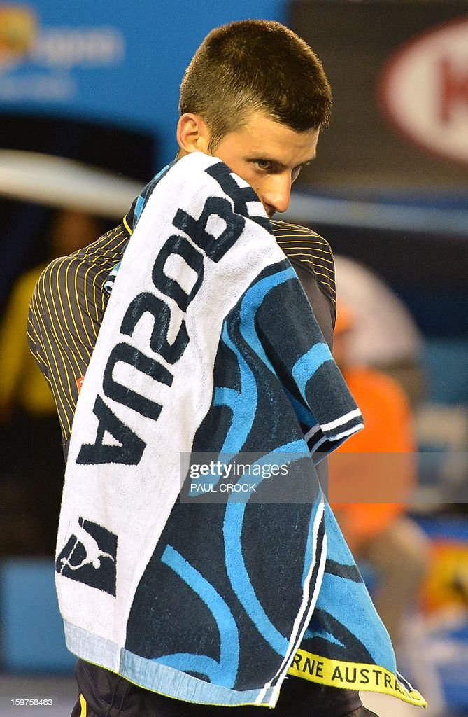Serbia's Novak Djokovic walks to his chair during his men's singles match against Switzerland's Stanislas Wawrinka on day seven of the Australian Open tennis tournament in Melbourne on January 20, 2013.