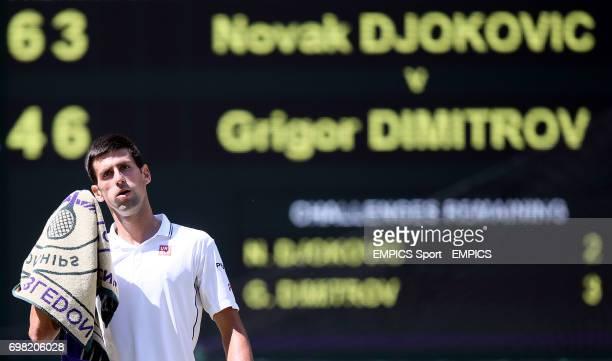 Serbia's Novak Djokovic wipes away sweat during his match against Bulgaria's Grigor Dimitrov