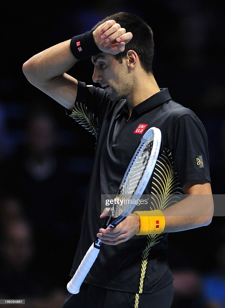 Serbia's Novak Djokovic wipes his brow during the singles final against Switzerland's Roger Federer on the eighth day of the ATP World Tour Finals tennis tournament in London on November 12, 2012.