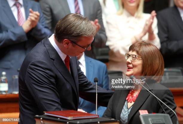 Serbia's outgoing prime minister Aleksandar Vucic is being congratulated by the parliament speaker Maja Gojkovic as he sworn in as president at the...