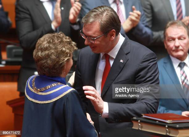 Serbia's outgoing prime minister Aleksandar Vucic receives greetings after sworn in as president at the Assembly in Belgrade Serbia on May 31 2017