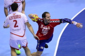 Serbia's pivot Alem Toskic shoots past Spain's left back Alberto Enterrios during the 23rd Men's Handball World Championships round of 16 match...