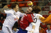 Serbia's pivot Alem Toskic vies with Korea's back YunSuk Oh during the 23rd Men's Handball World Championships preliminary round Group C match Serbia...