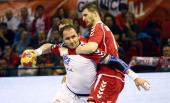 Serbia's pivot Alem Toskic vies with Poland's pivot Piotr Grabarczyk during the 23rd Men's Handball World Championships preliminary round Group C...