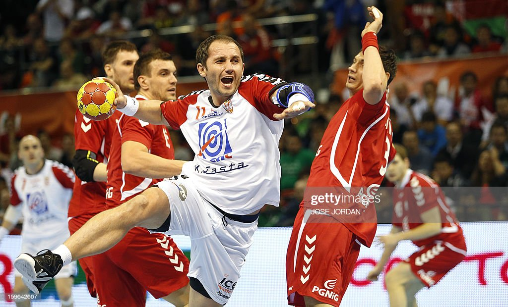 Serbia's pivot Alem Toskic (L) vies with Poland's right back Krzystof Lijewski during the 23rd Men's Handball World Championships preliminary round Group C match Poland vs Serbia at the Pabellon Principe Felipe in Zaragoza on January 17, 2013.