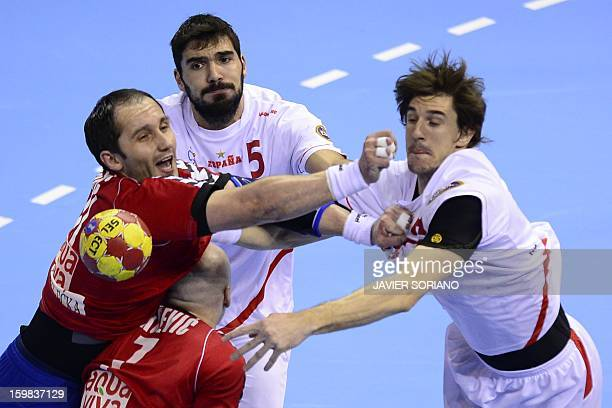 Serbia's pivot Alem Toskic vies with Spain's right back Jorge Maqueda and Spain's left back Viran Morros during the 23rd Men's Handball World...