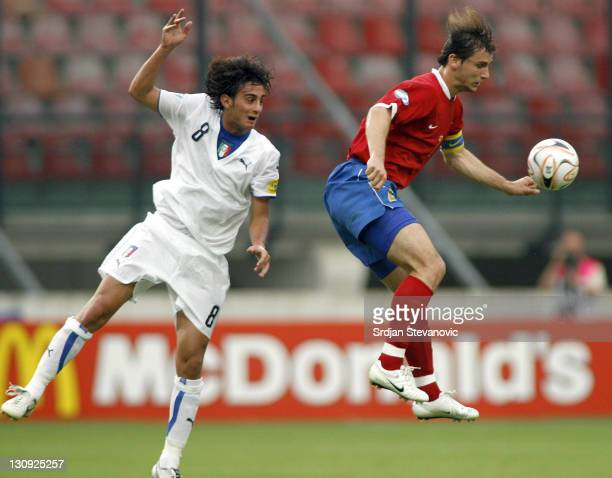 Serbia's player Branislav Ivanovic right in action against Italy's Alberto Aquilani during Serbia vs Italy UEFA European Under 21 Championship Group...