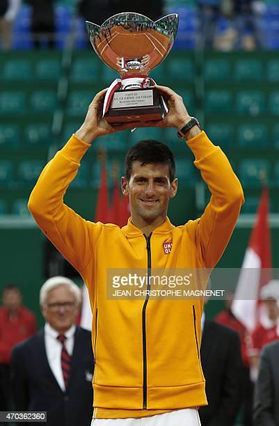 Serbia's player Novak Djokovic holds his trophy during the MonteCarlo ATP Masters Series Tournament final tennis match against Czech Republic's Tomas...