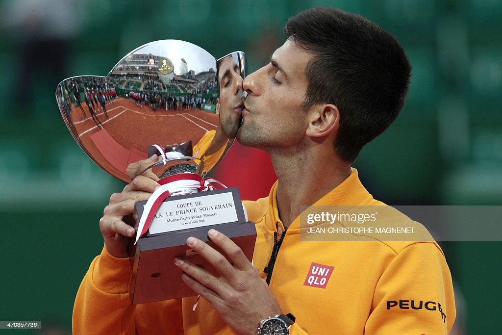 Serbia's player Novak Djokovic kisses his trophy after winning against Czech Republic's Tomas Berdych in the MonteCarlo ATP Masters Series Tournament...