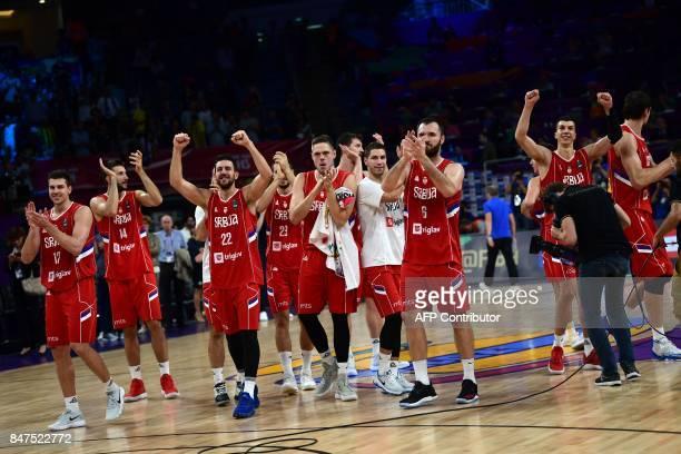 Serbia's players celebrate after winning the FIBA Eurobasket 2017 men's Semi Final basketball match between Russia and Serbia at Sinan Erdem Sport...
