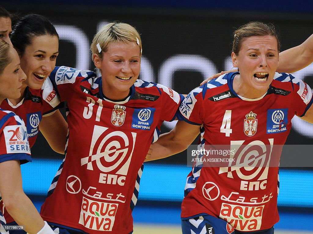 Serbia's players celebrate their victory against Ukraine at the end of their 2012 EHF European Women's Handball Championship match on December 6 , 2012, at the KOMBANK Arena in Belgrade. Serbia won 25-23. AFP PHOTO / ATTILA KISBENEDEK