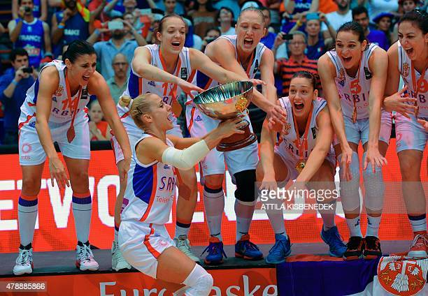 Serbia's players celebrate their victory in the EuroBasket Women 2015 final basketball match between Serbia and France in Budapest on June 28 2015...