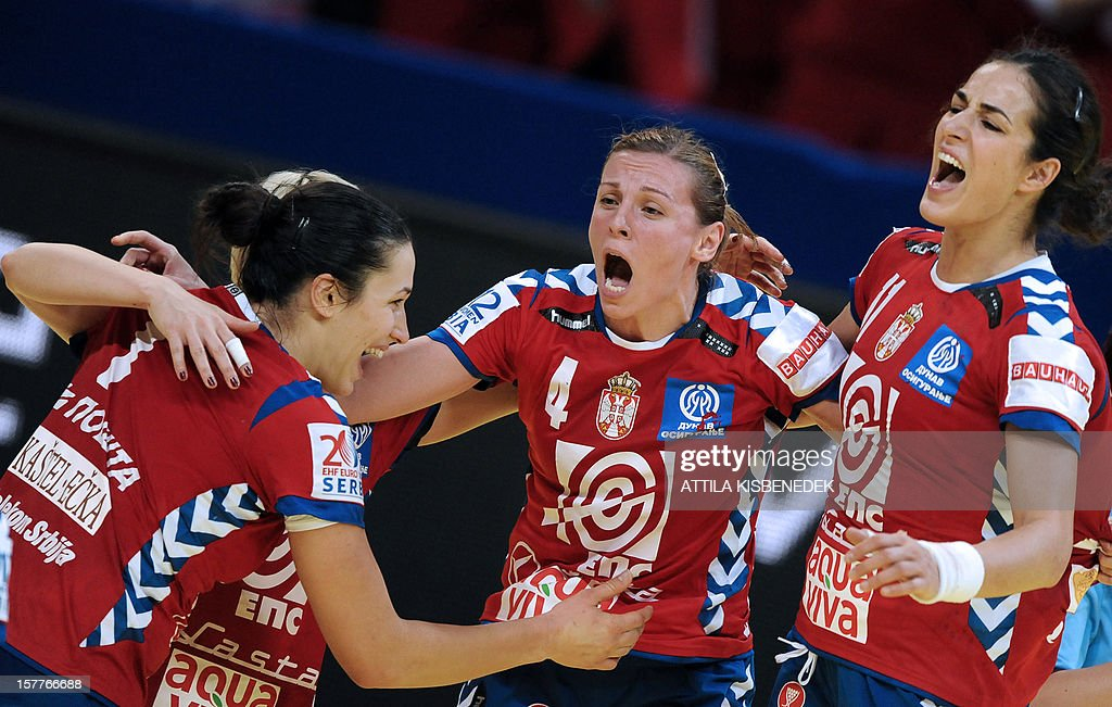 Serbia's players celebrate their victory over Ukraine at the end of their 2012 EHF European Women's Handball Championship match against Ukraine on December 6 , 2012, at the KOMBANK Arena in Belgrade. Serbia won 25-23.