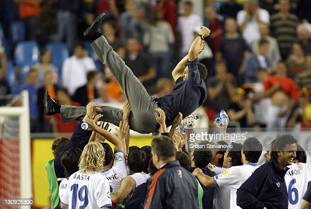 Serbia's players celebrate victory with head coach Miroslav Djukic during UEFA European Championship Under 21 semifinals match between Belgium U21...