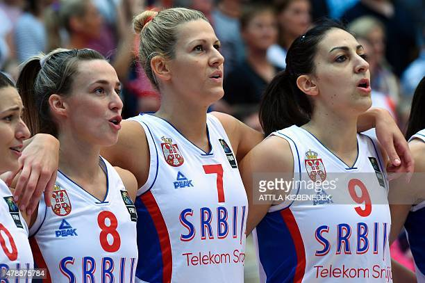 Serbia's players Dajana Butulija Nevena Jovanovic Sara Krnjic and Jelena Milovanovic sing their national anthem prior to the final basketball match...