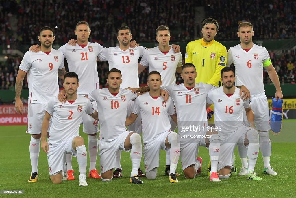 Serbia's players pose for a family picture before the FIFA World Cup 2018 qualification football match between Austria and Serbia at the Ernst Happel stadium in Vienna on October 6, 2017. /