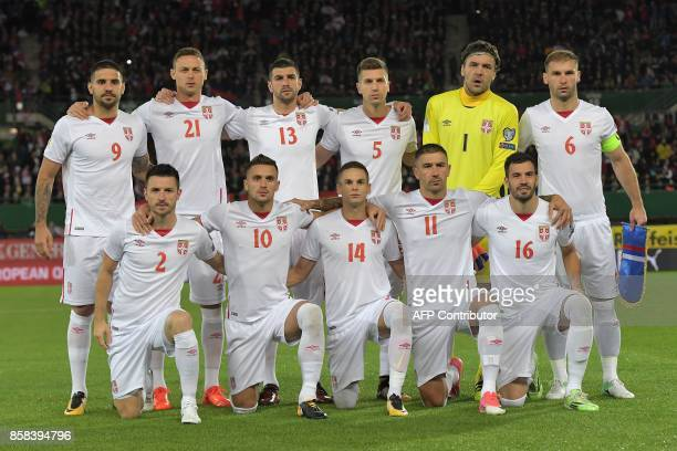 Serbia's players pose for a family picture before the FIFA World Cup 2018 qualification football match between Austria and Serbia at the Ernst Happel...