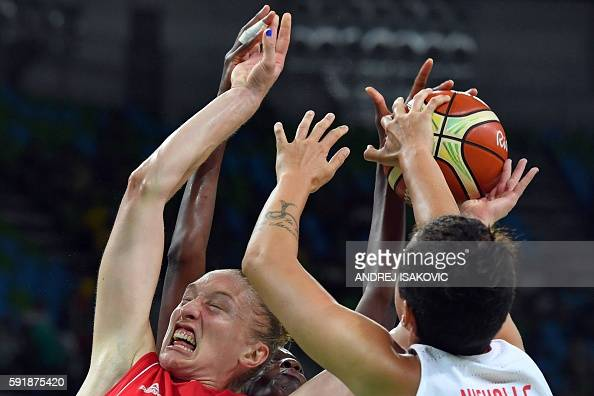 TOPSHOT Serbia's power forward Danielle Page and Spain's power forward Laura Nicholls go for a rebound during a Women's semifinal basketball match...