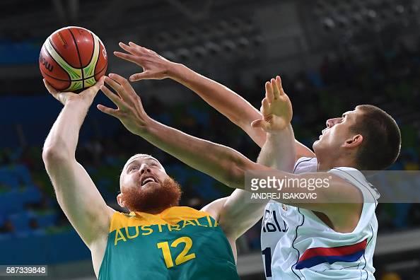 TOPSHOT Serbia's power forward Nikola Jokic defends against Australia's forward Aron Baynes during a Men's round Group A basketball match between...