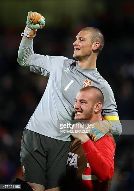 Serbia's Predrag Rajkovic and Vanja Milinkovic celebrate after the FIFA Under20 World Cup football semifinal match between Serbia and Mali in...