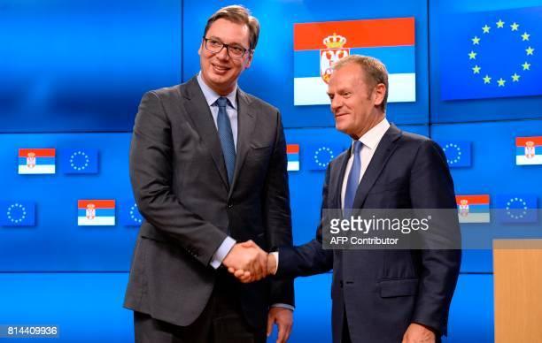 Serbia's President Aleksandar Vucic shakes hands with European Union Council President Donald Tusk following their meeting at the European Union...