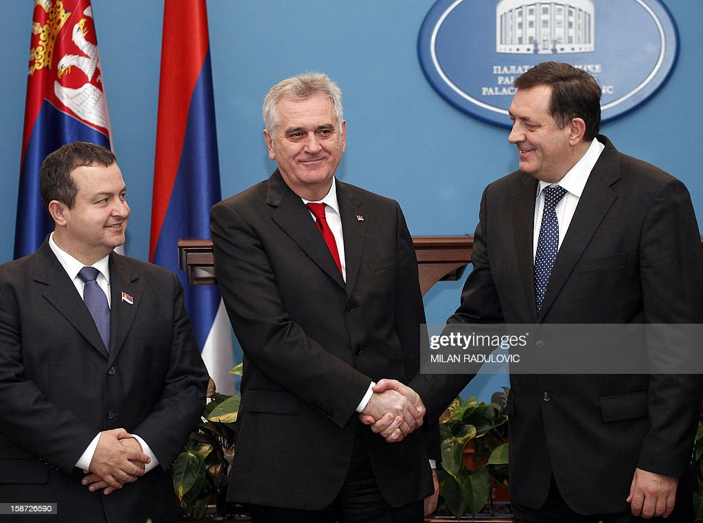 Serbia's President Tomislav Nikolic (C), accompanied by his Prime Minister Ivica Dacic (L), shakes hands with the president of Bosnia's Serb entity 'Republika Srpska' Milorad Dodik (R), during a visit to the Western-Bosnian town of Banja Luka, on December 26, 2012. Nikolic and Dacic are on a one-day un-official visit.